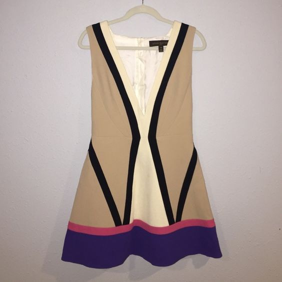 Louis Vuitton Multi Color Dress Amazing dress! Only worn once. 100% authentic. Seen on Nikki Hilton. Deep v-neck. Large arm holes. Zips up back. Small stains on cream bottom part of dress (just needs to be dry cleaned) Louis Vuitton Dresses Mini