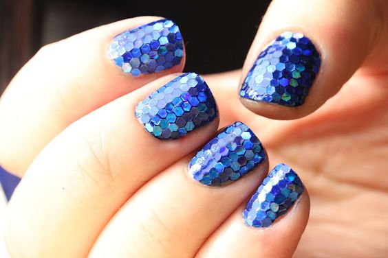 Electric Mermaid Scales nails. This must've taken forever to tile the glitter piece by piece! Also I'm going to have some fun exploring this blog (Polish All the Nails).