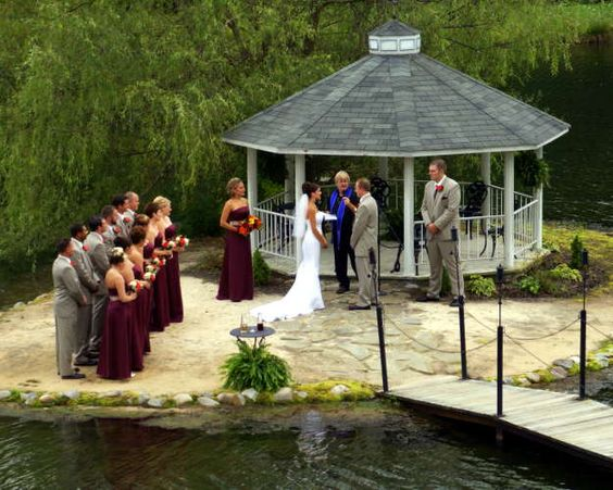 Bride and Groom exchange vows as their bridal party looks on, while celebrating Lakeside at the Hayloft.
