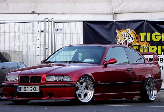 Calypsorot BMW e36 coupé on cult classic OZ AC Schnitzer type 1 wheels