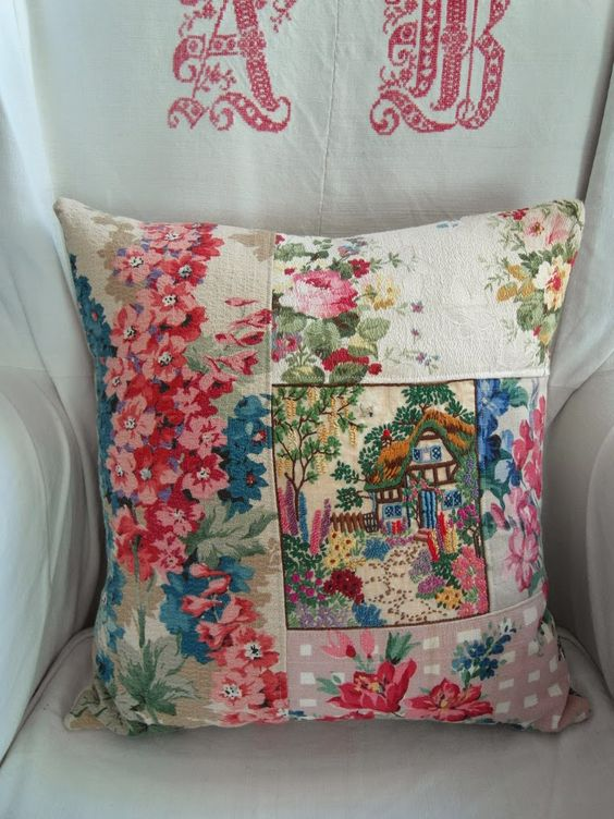 cottage cushion, brilliant use for panels of vintage cottage garden embroidery