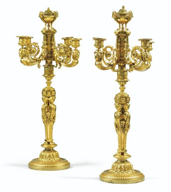 Paire de candélabres en bronze doré de style Louis XVI, d'après un dessin de Jean-Démosthène Dugourc  A PAIR OF GILT-BRONZE CANDELABRA IN LOUIS XVI STYLE, AFTER A DESIGN BY JEAN-DÉMOSTHÈNE DUGOURC