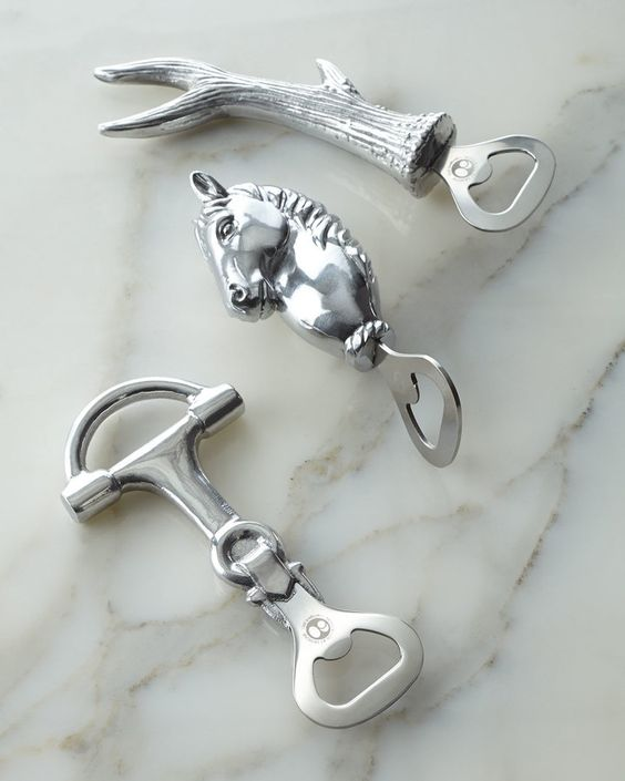 """Handcrafted of aluminum. Hand wash. Sold individually; select style when ordering. Equestrian, 2.75""""W x 5.75""""L. Horse, 2""""W x 6.5""""L. Antler, 3""""W x 7""""L. Imported."""