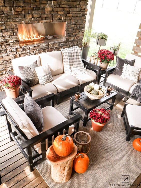 Outdoor Living Space all decorated for fall with natural stone fireplace and pumpkins throughout! Keep it simple but festive.