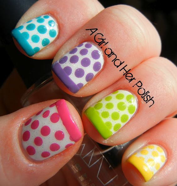 Polka dots with tips  @Cathy Ma Ma Ma Ma Ma Parker (I have seen polish that comes with templates that you stick to your nails and then remove after the applying the polish. This looks like a template.)