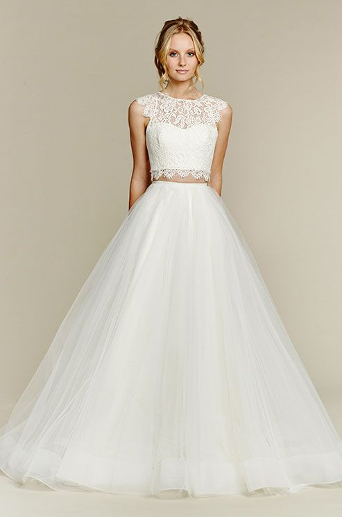 Ivory two-piece ball gown, lace crop top with jewel neckline and soft cap sleeve, scallop detail at waist and keyhole back, full tulle skirt with horsehair hem. Blush, Fall 2015: