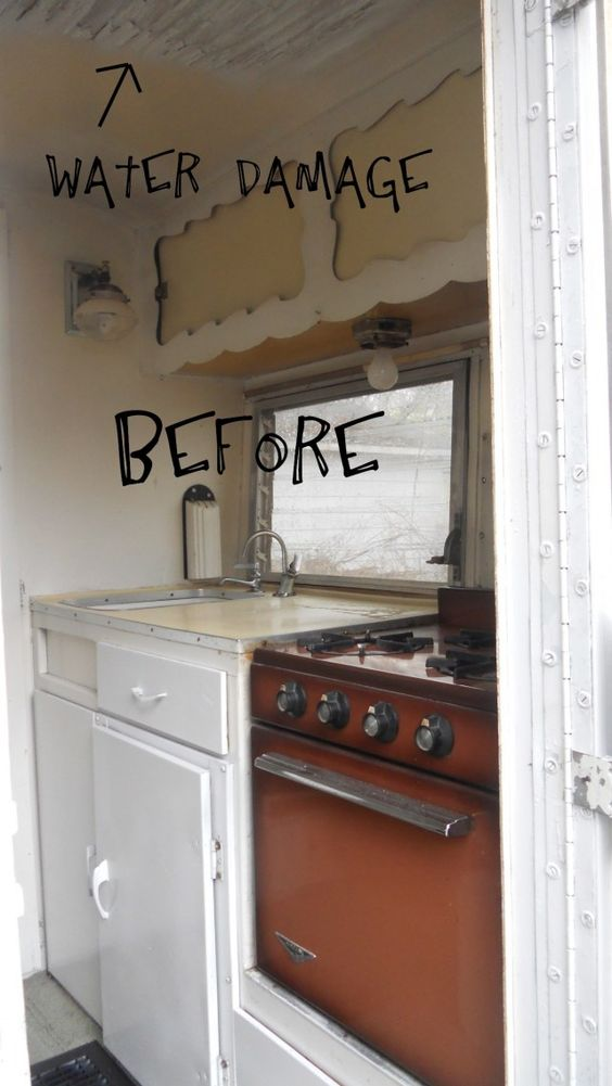 """Redo of little trailer.  This is the """"before"""" picture. The """"after"""" is also on this board; it's the adorable kitchen with the bright turquoise paint on the cupboard insets (where the yellow is in this shot)."""