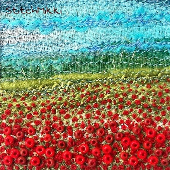 """Beaded and embroidered poppy field. A 2 inch square miniature fabric landscape created using fabric, fancy yarns, beads and embroidery thread."""