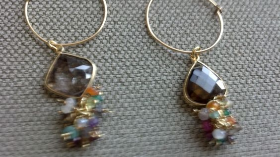 Hoops with Topaz gems