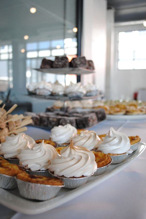 Various finger foods at a graduation function that we catered for: cocktail lemon meringue pies, cocktail milk tarts, laminations.