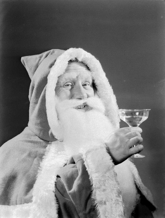 Father Christmas drinking a toast