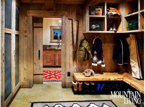 The mud room but also the sliding barn door revealing the laundry room! Rustic Redefined | Mountain Living