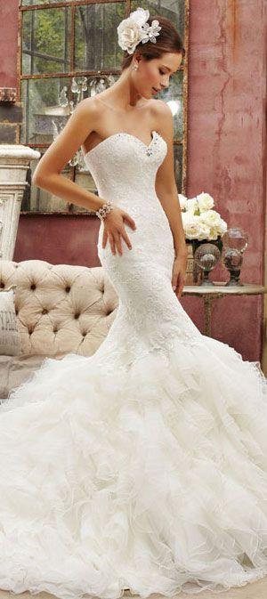 wellfigured.com: #corsetted #wedding gown.