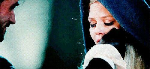 Wiping away her tears...