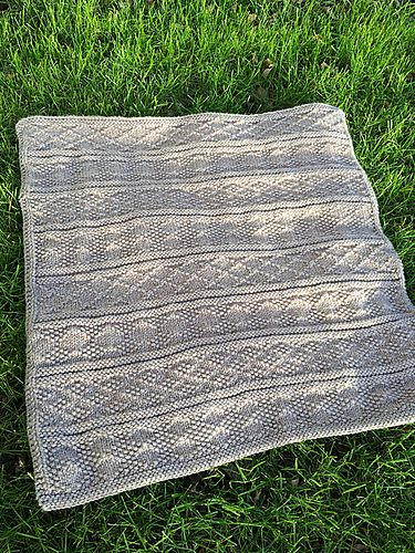 A beautiful, unisex baby blanket in Guernsey, or Gansey, patterns. This class...