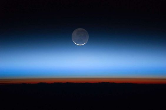 The moon over layers of the Earth's atmosphere. - REUTERS/NASA
