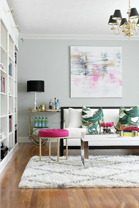 Bliss at Home 2015 Summer Home Tour living room with pops of bright color, DIY Ikea bookcases made to look built-in, palm print pillows, gold decor, vintage bar cart, DIY abstract art, black and white sofa, Moroccan shag rug,: