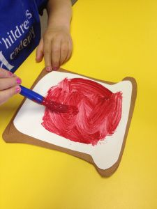 j is for jam preschool craft: We used plastic knives to spread the Jam (red paint) onto the bread.