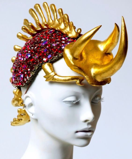 -I find this had particularly interesting as the materials and shape or related. The hat shaped as a rhino which is often seen as strong powerful is decorated with colours (gold) and materials (jewels) that are also related to these things. I could use this to help me give meaning to my design by linking not only the shape but also the colours I use for it.  {Animals//Armour}