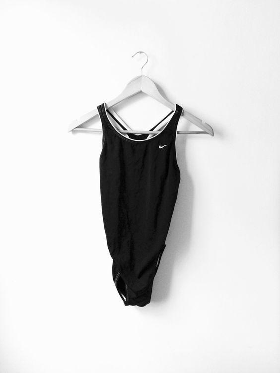 Vintage Nike Black 1-Piece Bathing Suit by Slumgull on Etsy https://www.etsy.com/listing/230145042/vintage-nike-black-1-piece-bathing-suit
