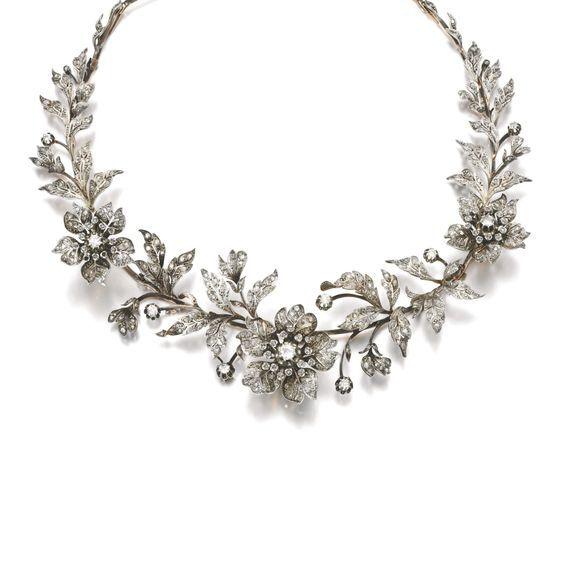 DIAMOND TIARA, LATE 19TH C.,Designed as a foliate spray set with circular-cut and rose diamonds, the 3 flowers set en tremblent, fitted case, accompanied by 3 tiara frames,5 hair pin fittings, 4 brooch pins and 5 original drawings depicting the various combinations for the jewels to be worn as a tiara, necklace, aigrette, brooches and corsage ornament, 4 small rose diamonds deficient. Property of a lady of title.