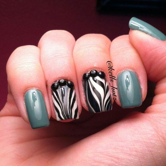 Instagram @Kells_Hotz #nails #makeup #fashion #glitter #watermarble #zebra #turquoise #animalprint