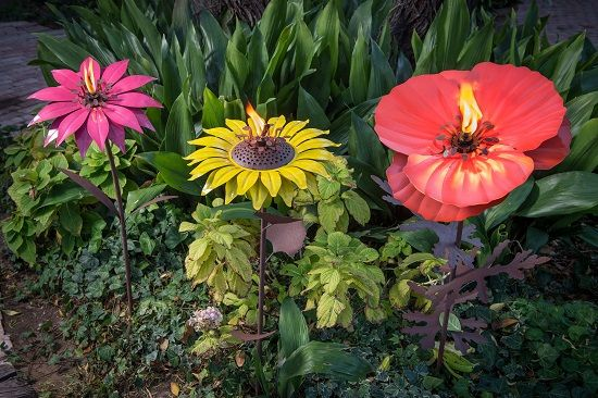 Desert Steel - Bishop Dahlia, Sunflower, and Poppy.  I got mine from QVC and love them. 1 had a bit of the coating missing on the canister (stamen) and I called Desert Steel and they quickly got my info and are sending it out right away.