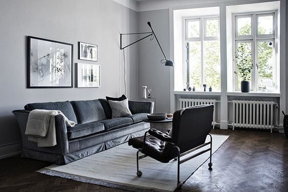 Sitting room in monochrome and indigo and a Flos 265 light.