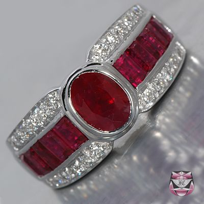 This Art Deco style Ruby Ring is of considerable weight and presence, measuring 9mm wide and 6.5mm deep and is constructed in 18k white gold. Weighing 7.8g and collectively mounted with 4.04cts of oval and baguette rubies graded 'lively crimson' color and 'good to fair' clarity