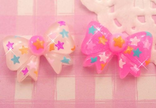 Kawaii white and pink glitter ribbon bows with cute and colourful stars. These #kawaii style flat back resin #cabochons are perfect for all kinds of crafts, from #decoden to #jewellery. #DIY
