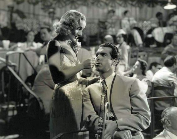 """Skid Johnson (Fred MacMurray): """"How about meeting me on the dock, under the moon?"""" // Maggie King (Carole Lombard): """"What if there isn't a moon?"""" // Skid Johnson: """"I'll meet you under the dock!"""" -- from Swing High, Swing Low (1937) directed by Mitchell Leisen"""
