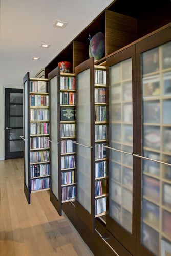 A DVD collection as impressive as this needs to be organized with care, but it's not always ideal to keep it on display. These doors pull out for storage with easy access.