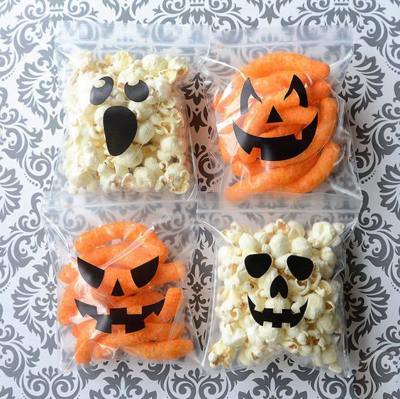 Stick spooky decals on plastic baggies for a Halloween snack.: