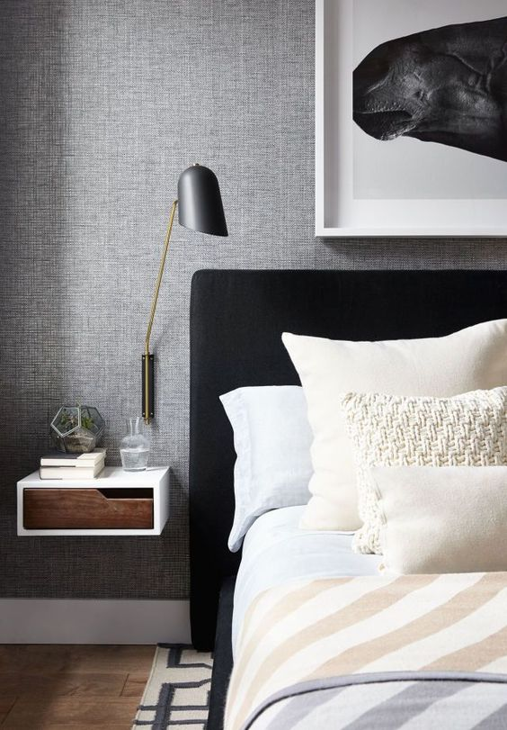 Floating side table and black upholstered headboard