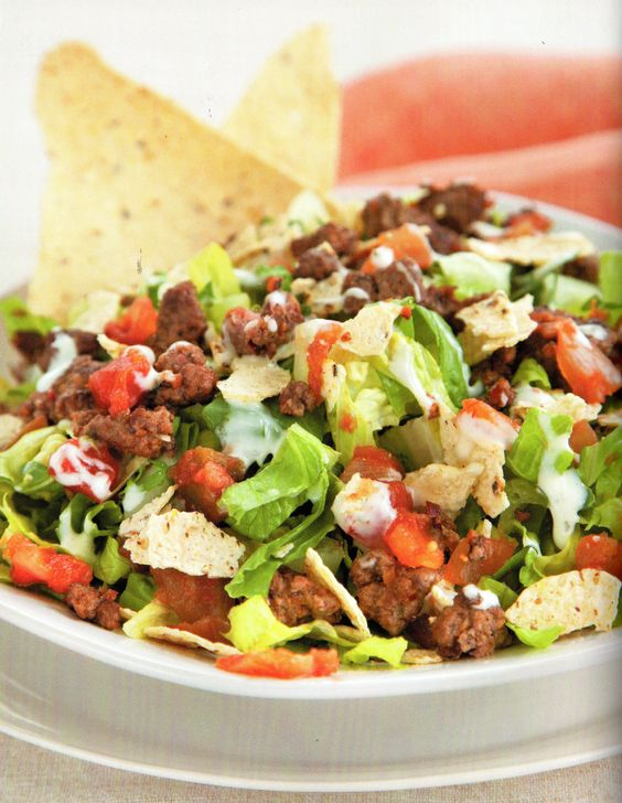 Healthier than its restaurant counterpart, this taco salad is loaded with hot ground beef, refreshing pico de gallo and crunchy tortilla chips—yum!