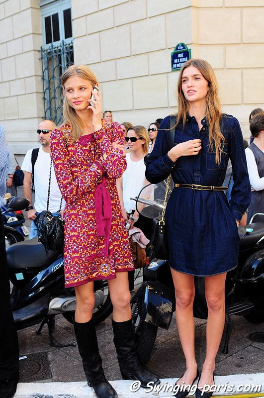 Fashion week: Models wearing a printed mini dress, flat black knee length boots and navy shirt dress with flats <3. Soo cute for Ava