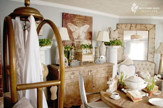 Beautiful chair makeover featured and also just look at that butterfly print on the back wall.