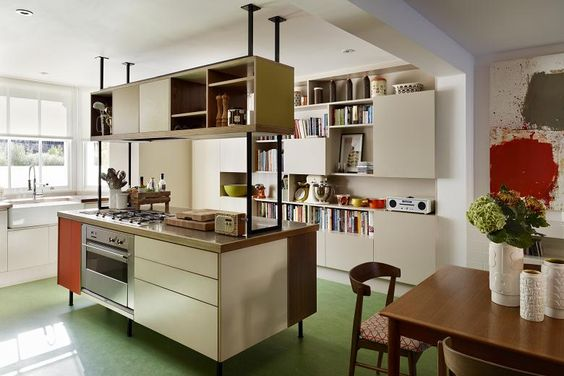 The kitchen, with green marmoleum flooring.