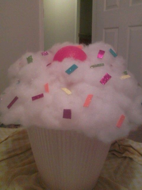Candyland party: Huge cupcake out of a lampshade, foam board, pillow stuffing, foamy glitter stickers, and a red ball(cherry) from the Dollar Tree!! Too cute!!!
