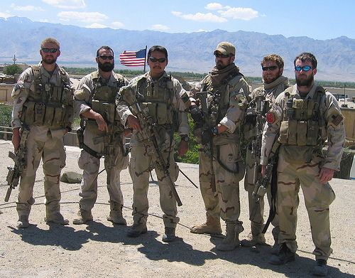 Navy SEAL Lt. Michael Murphy (far right) led a team of 3 SEALS, Matt Axelson (far left), Marcus Luttrell (hat) and Danny Dietz (not shown), on a recon mission deep in the mountains of Afghanistan in 2005. A group of goat herders stumbled upon their position. The SEALs decided to let them go. Later in the day a large group of Taliban militants, tipped off by the goat herders, ambushed the team. After a fierce firefight only Luttrell remained alive. Murphy received the Medal of Honor…