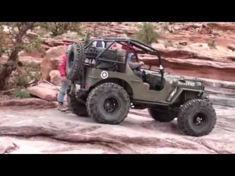 """Easter Jeep Safari 2010. Taking my Willys MB on the Moab Rim Trail. I did this last year with my JK so I let my buddy the """"Troublemaker"""" from Illinois have a little fun. Only the V8 engined Jeeps made it to the top of the Sand Dune at max throttle. The MB did it at half power!! Go to www.jeepingoffroad.com for the Willys build up and more Jeepin..."""