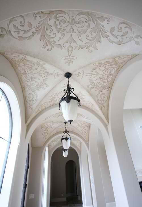 beautiful stencil design and arched ceiling for hallway to