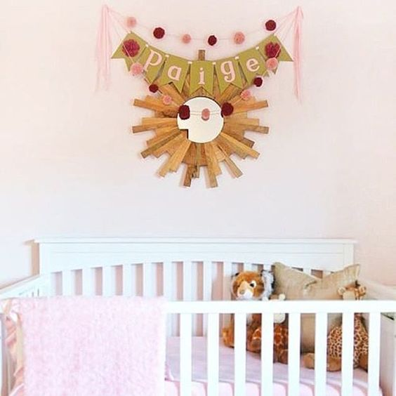 loving the layered wall decor over the crib via