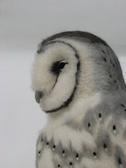 This is an amazing work of art and a wonderful story behind the creator.  Gorgeous needle felted owl