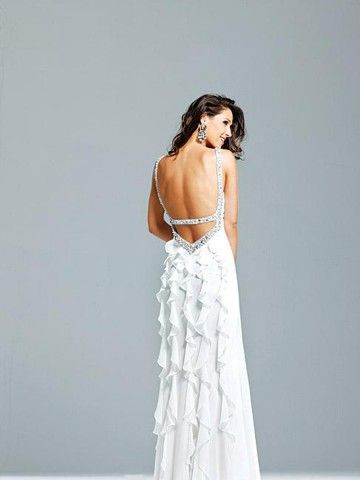 Not the backlessness....I just like the vertical ruffles.  Book marking this to show the dressmaker :)