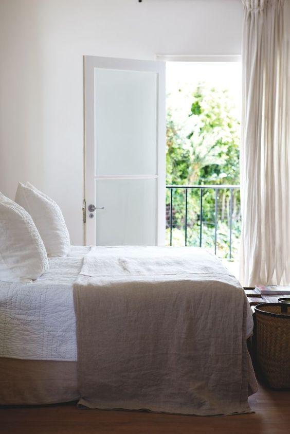 A serene white bedroom with natural linen decor. #allwhite
