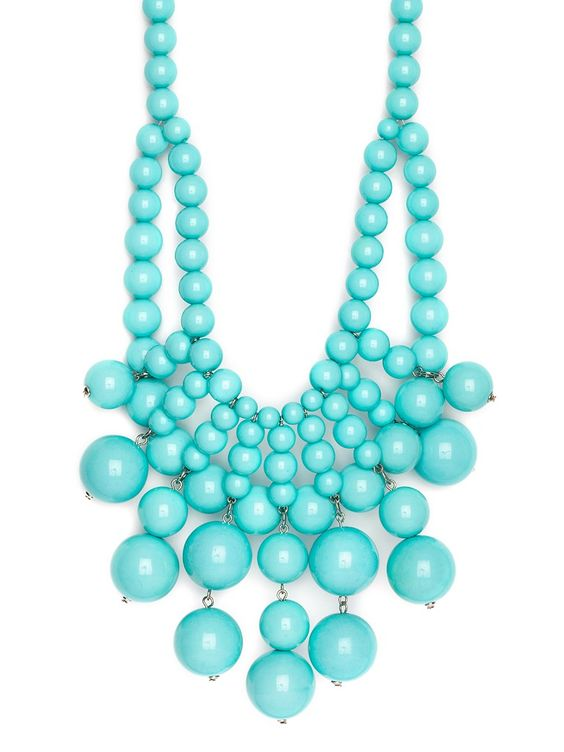 Flaunt your ladylike side with this gorgeous bib necklace, cast in a pretty shade of bright turquoise. Crafted from glossy beads, both big and small, the style comes in an audacious sunburst design for a look that's truly bold and beautiful.