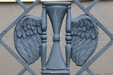 Wrought Iron Winged Hourglass, St. Louis Cemetery 2, New Orleans...one of 11 Hidden Spots to Enter the Underworld. Atlas Obscura