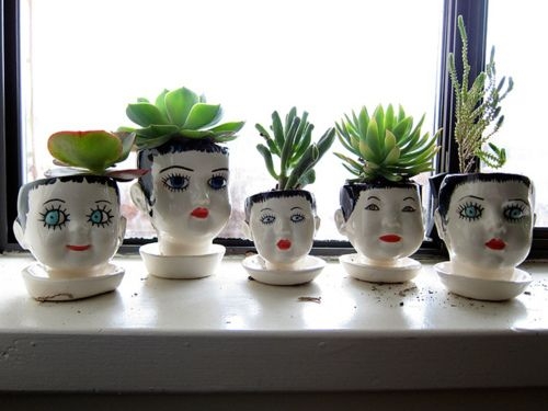 Doll head planters | photo by jeannette ordas (so funny to see my planters, my old windowsill & my photo on pinterest!!):