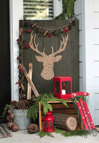 Christmas front porch with rustic natural winter elements in reds greens browns: